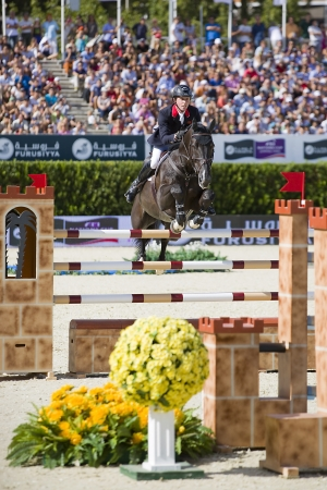 horse jumping: Ben Maher from Great Britain jumps a horse jumping obstacle at CSIO - Furusiyya Nations Cup Horse Jumping Final Competition, on September 29, 2013, in Barcelona, Spain