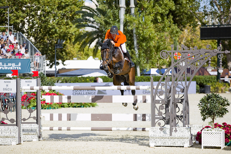 snob: Jur Vrieling from Netherlands jumps a horse jumping obstacle at CSIO - Furusiyya Nations Cup Horse Jumping Final Competition, on September 29, 2013, in Barcelona, Spain Editorial