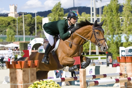 horse jumping: Rodrigo Pessoa from Brazil jumps a horse jumping obstacle at CSIO - Furusiyya Nations Cup Horse Jumping Final Competition, on September 29, 2013, in Barcelona, Spain