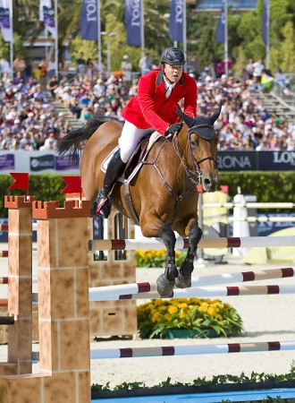 horse jumping: Fran�ois Mathy from Belgium jumps a horse jumping obstacle at CSIO - Furusiyya Nations Cup Horse Jumping Final Competition, on September 29, 2013, in Barcelona, Spain