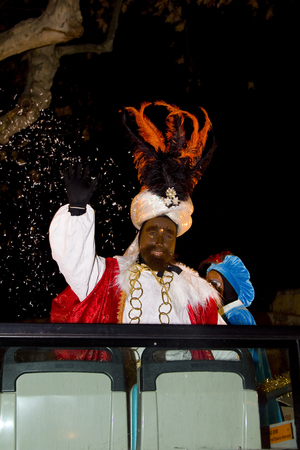 melchor: Balthazar King at the Biblical Magi Three Kings parade, who give toys to the children  Is a traditional spanish celebration  January 5, 2012 in Alella, Barcelona, Spain