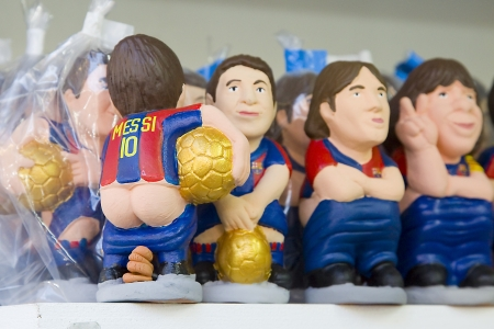 Caganers, originally a character in Catalan mythology, now portraying famous celebrities or characters on sale at Santa Llucia Christmas Fair in Barcelona, Spain Stock Photo - 24269249