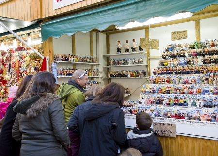 People visits the famous Santa Llucia Fair, Barcelona, Spain, to buy Christmas decoration, as fir trees and crib figures