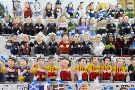 Caganers, originally a character in Catalan mythology, now portraying famous celebrities or characters on sale at Santa Llucia Fair, on December 1, 2013, in Barcelona, Spain Stock Photo - 24375301