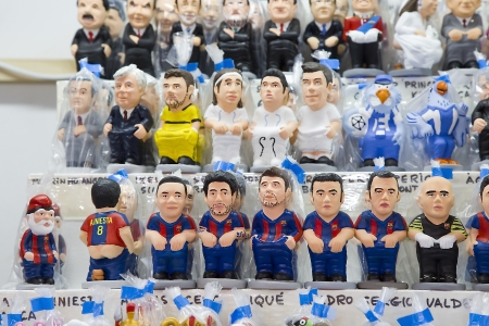 Caganers, originally a character in Catalan mythology, now portraying famous celebrities or characters on sale at Santa Llucia Fair, on December 1, 2013, in Barcelona, Spain Stock Photo - 24375303