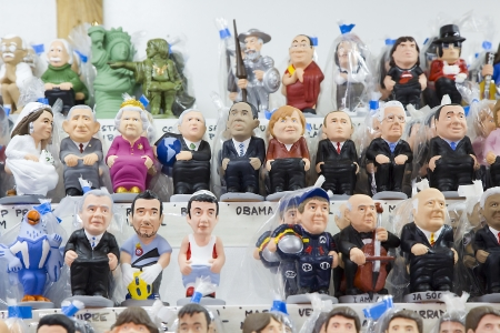 Caganers, originally a character in Catalan mythology, now portraying famous celebrities or characters on sale at Santa Llucia Fair, on December 1, 2013, in Barcelona, Spain Stock Photo - 24375304