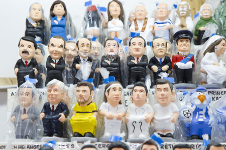 Caganers, originally a character in Catalan mythology, now portraying famous celebrities or characters on sale at Santa Llucia Fair, on December 1, 2013, in Barcelona, Spain Stock Photo - 24375305