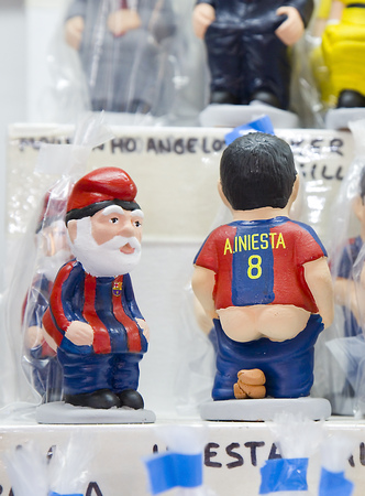 Caganers, originally a character in Catalan mythology, now portraying famous celebrities or characters on sale at Santa Llucia Fair, on December 1, 2013, in Barcelona, Spain Stock Photo - 24375308