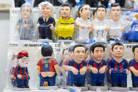 Caganers, originally a character in Catalan mythology, now portraying famous celebrities or characters on sale at Santa Llucia Fair, on December 1, 2013, in Barcelona, Spain Stock Photo - 24375309