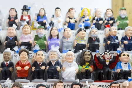 Caganers, originally a character in Catalan mythology, now portraying famous celebrities or characters on sale at Santa Llucia Fair, on December 1, 2013, in Barcelona, Spain Stock Photo - 24375310