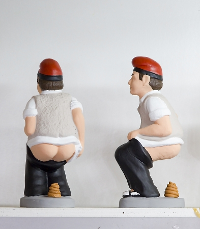 Caganers, originally a character in Catalan mythology, now portraying famous celebrities or characters on sale at Santa Llucia Fair, on December 1, 2013, in Barcelona, Spain Stock Photo - 24375312
