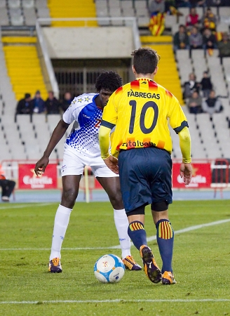 fabregas: Cesc Fabregas in action at friendly football match between Catalonia and Cape Verde, 4-1, on December 30, 2013, in Barcelona, Spain