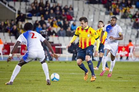 Cesc Fabregas in action at friendly football match between Catalonia and Cape Verde, 4-1, on December 30, 2013, in Barcelona, Spain