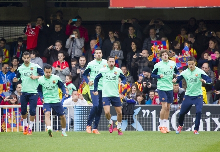 xavi: Some players in action at FC Barcelona team in open doors training session at Mini Estadi stadium, with 13,200 spectators, on January 3, 2014, in Barcelona, Spain
