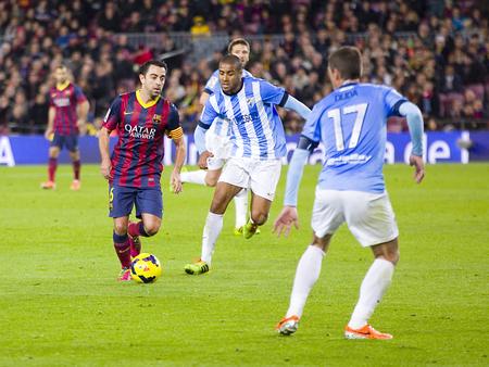 xavi: Xavi Hernandez in action at Spanish league match between FC Barcelona and Malaga CF, final score 3-0, on January 26, 2014, in Barcelona, Spain Editorial
