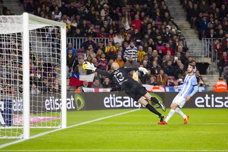 willy: Willy Caballero of Malaga save a goal at Spanish league match between FC Barcelona and Malaga CF, final score 3-0, on January 26, 2014, in Barcelona, Spain