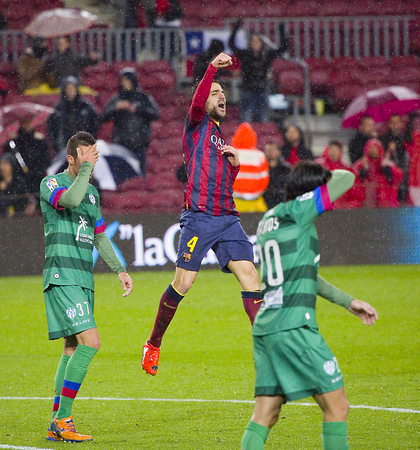 Cesc Fabregas celebrates his goal at Copa del Rey - Spanish Cup - match between FC Barcelona and Levante, 5-1, under an intense rain, on January 29, 2014, in Barcelona, Spain