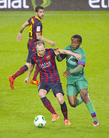 iniesta: Andres Iniesta in action at Copa del Rey - Spanish Cup - match between FC Barcelona and Levante, 5-1, under an intense rain, on January 29, 2014, in Barcelona, Spain Editorial