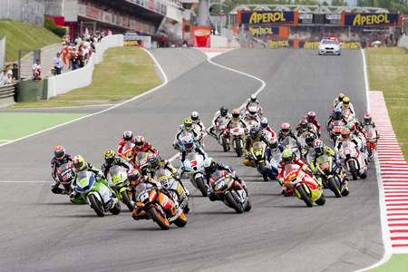moto gp: Some motorcycle riders compete at the race of Moto 2 Grand Prix of Catalunya, on June 3, 2012 in Barcelona, Spain