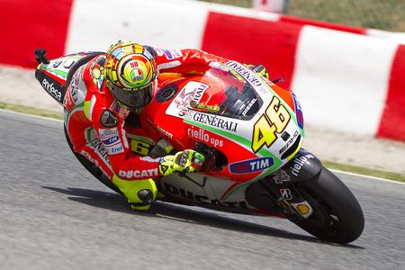 moto gp: Valentino Rossi of Ducati team racing at Free Practice Session of MotoGP Grand Prix of Catalunya, on June 1, 2012 in Barcelona, Spain
