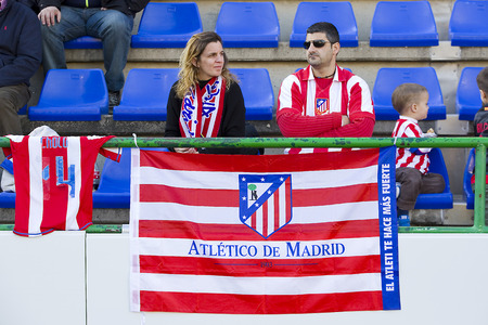 Unidentified supporters at Spanish Cup match between Sant Andreu and Atletico de Madrid, final score 0-4, on December 7, 2013, in Barcelona, Spain