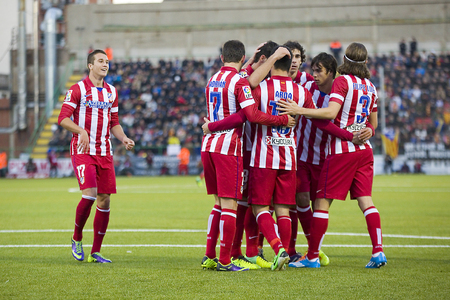 Atletico players celebrating a goal at Spanish Cup match between Sant Andreu and Atletico de Madrid, final score 0-4, on December 7, 2013, in Barcelona, Spain