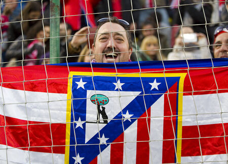 Atletico unidentified supporter with a flag at Spanish Cup match between Sant Andreu and Atletico de Madrid, final score 0-4, on December 7, 2013, in Barcelona, Spain