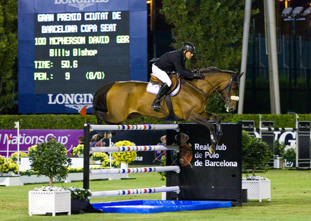snob: David McPherson from Great Britain in action during the CSIO 100th International Jumping Competition, on September 23, 2011, in Real Club de Polo, Barcelona, Spain  Editorial