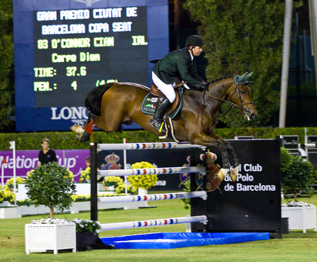 cian: Cian O Connor from Ireland in action during the CSIO 100th International Jumping Competition, on September 23, 2011, in Real Club de Polo, Barcelona, Spain