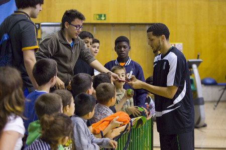 Devoe Joseph of Joventut signing autographs at Spanish Basketball League match between Joventut and Zaragoza, final score 82-57, on April 13, 2014, in Badalona, Spain Stock Photo - 27792858