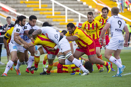 Some players in action at rugby Top14 french league match between USAP Perpignan and Toulon, final score 31-46, on April 19, 2014, in Barcelona Olympic stadium, Spain