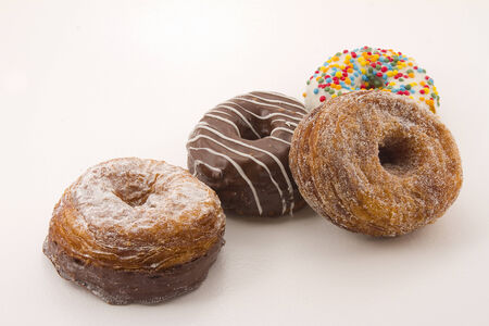 Cronuts, a half-donut and half-croissant pastries isolated on white
