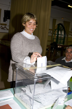 An unidentified woman delivers his vote in a polling station during Catalonian parliamentary election, on November 25, 2012 in Barcelona, Spain