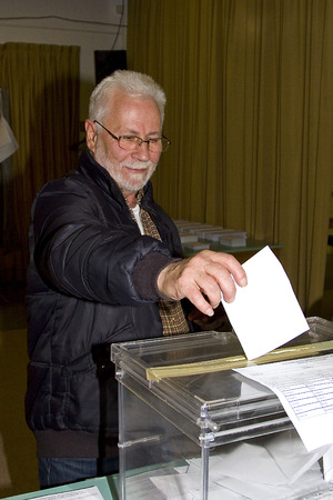 polling station: An unidentified man delivers his vote in a polling station during Catalonian parliamentary election, on November 25, 2012 in Barcelona, Spain