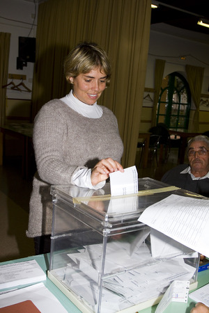 polling: An unidentified woman delivers his vote in a polling station during Catalonian parliamentary election, on November 25, 2012 in Barcelona, Spain