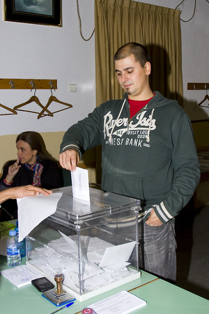 parliamentary: An unidentified man delivers his vote in a polling station during Catalonian parliamentary election, on November 25, 2012 in Barcelona, Spain