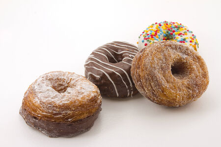 Cronuts isolated on white photo