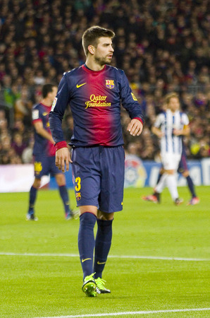 barsa: Gerard Pique in action during the Spanish League match between FC Barcelona and RCD Espanyol, 4 - 0, on January 6, 2013, in Barcelona, Spain Editorial