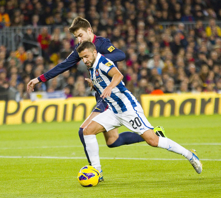 barsa: Gerard Pique and Simao in action during the Spanish League match between FC Barcelona and RCD Espanyol, 4 - 0, on January 6, 2013, in Barcelona, Spain