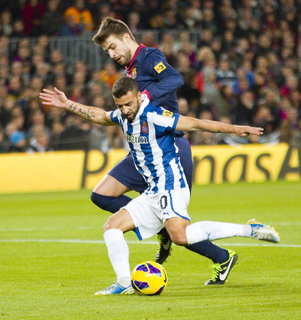 Gerard Pique and Simao in action during the Spanish League match between FC Barcelona and RCD Espanyol, 4 - 0, on January 6, 2013, in Barcelona, Spain