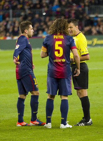 barsa: Carles Puyol in action during the Spanish League match between FC Barcelona and RCD Espanyol, 4 - 0, on January 6, 2013, in Barcelona, Spain