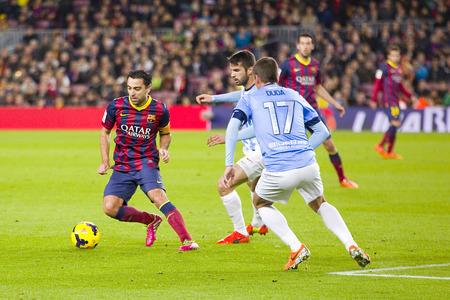xavi: Xavi Hernandez of FCB in action at Spanish league match between FC Barcelona and Malaga CF, final score 3-0, on January 26, 2014, in Barcelona, Spain
