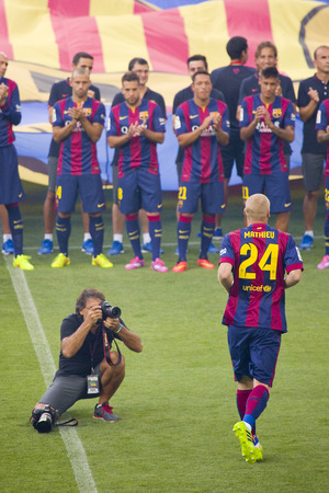 barsa: Jeremy Mathieu presentation in front of the home supporters before Gamper match between FC Barcelona and Club Leon, 6-0, on August 18, 2014, in Camp Nou, Barcelona, Spain Editorial