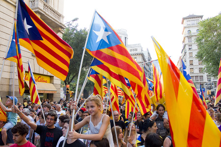 converge: Up to a million people converge on Barcelona to join a rally demanding independence for Catalonia, on September 11, 2012, in Barcelona, Spain