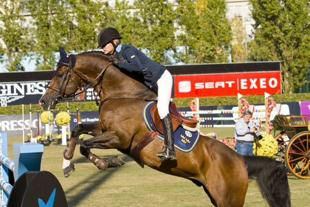 Malin Baryard Johnsson from Sweden rides horse H&M Tornesch at the 100th CSIO event at the Real Club de Polo Barcelona, on September 25, 2011, in Barcelona, Spain Editorial