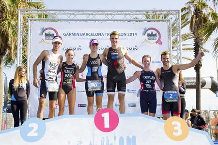 Winners of Garmin Barcelona Triathlon, on October 5, 2014, in Barcelona, Spain. L-R: Mario Mola, Anna Flaquer, Anna Godoy, Javier Gomez Noya, Eloise Crowley and Francesc Godoy