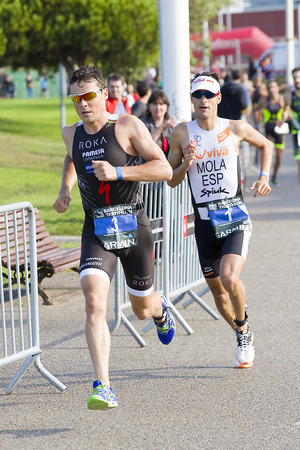 mario: Javier Gomez Noya and Mario Mola compete at Garmin Barcelona Triathlon, on October 5, 2014, in Barcelona, Spain. Noya wins the event. Mola finished in 2nd place Editorial