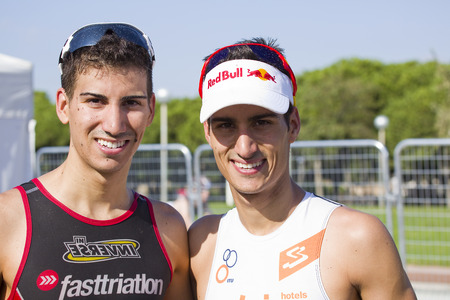mario: Lucas Mola and Mario Mola at Garmin Barcelona Triathlon, on October 5, 2014, in Barcelona, Spain. Javier Gomez Noya won the event. Mario mola finished in 2nd place