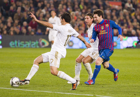 barsa: Alvaro Arbeloa and Leo Messi in action at the Spanish Cup match between FC Barcelona and Real Madrid, final score 2 - 2, on January 25, 2012, in Camp Nou, Barcelona, Spain
