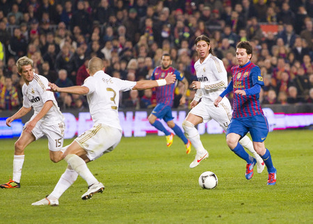 Leo Messi in action at the Spanish Cup match between FC Barcelona and Real Madrid, final score 2 - 2, on January 25, 2012, in Camp Nou, Barcelona, Spain Editorial